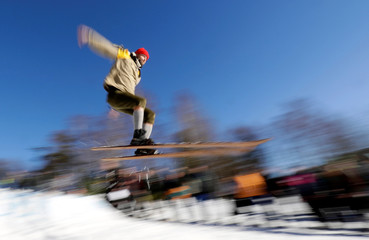 A participant jumps on vintage skis during a traditional historical ski race in the northern Bohemian town of Smrzovka