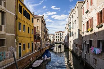 Italy: Boats in Venice canal, narrow street.