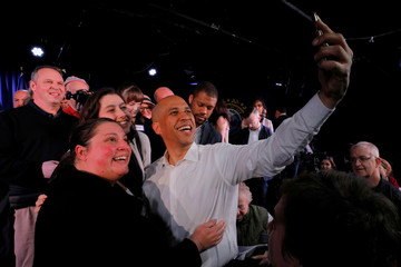 Democratic 2020 U.S. presidential candidate Cory Booker takes a selfie with audience members in Portsmouth