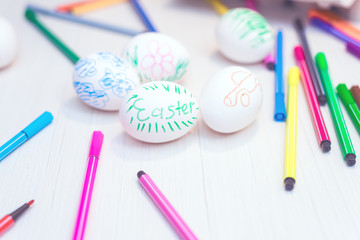 Easter eggs painted by child by hand. Easter ideas. Space for text. Happy easter.Toned image.