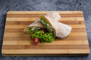 tasty wrap with chicken meat and greens