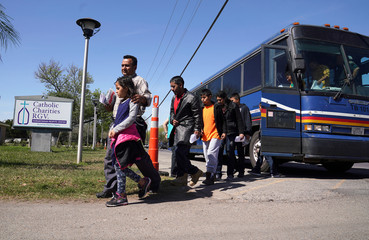 Asylum seekers are dropped off after being processed through immigration at the new Humanitarian Respite Center in McAllen