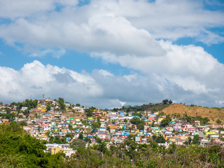 Small colored village on a hill. the southern town of Yauco sizzles with naturally saturated colors