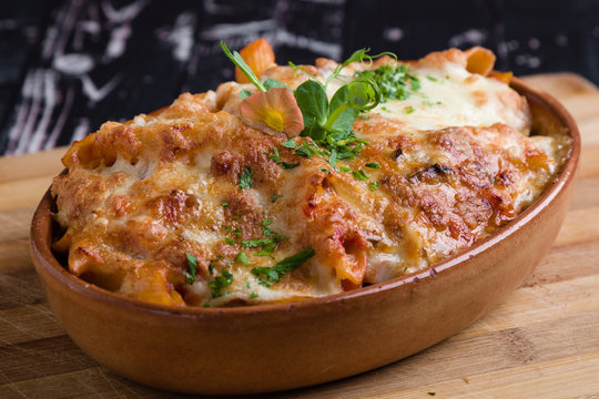 tasty delicious penne rigate pasta in rustic bowl