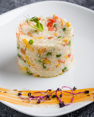 cooked tasty rice portion on white plate