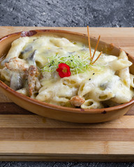 tasty delicious baked penne passta in a rustic bowl