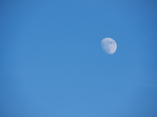 The moon against the blue sky. Natural background.