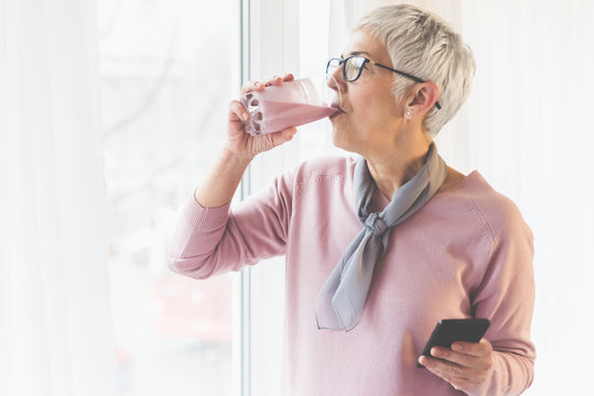 Woman drinking healthy smoothie