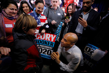 Democratic 2020 U.S. presidential candidate Cory Booker talks to nine year-old Alex Pringle in Portsmouth