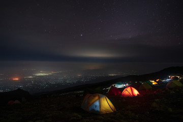 Moshi city by night from a camp on Kilimanjaro slopes