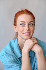 Cheerful redhead woman smiling