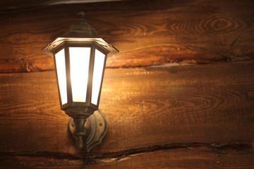 texture of  dark  wood  background with lantern