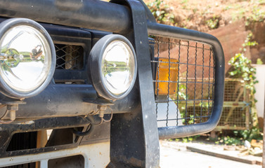 Pickup truck a font of 4 WD adventure off road font view has Bumper, turn signal, spotlight, towing, hook, headlights