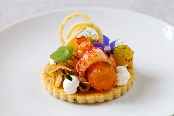 Thyme tart with crayfish, goat cheese mousse and tomato