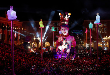 The float of the King of Carnival is paraded through the crowd during the 135th Carnival parade in Nice
