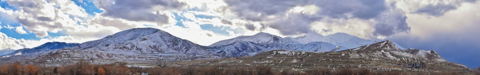 inter Panorama of Oquirrh Mountain range snow capped, which includes The Bingham Canyon Mine or Kennecott Copper Mine, rumored the largest open pit copper mine in the world in Salt Lake Valley, Utah.