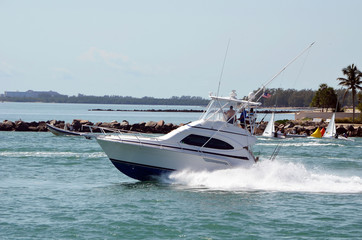 High-end sport fishing boat exiting Port of Miami through Government Cut