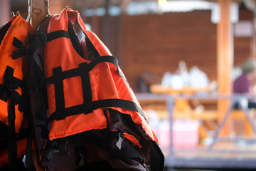 Life jacket hanging in floating hotel houses