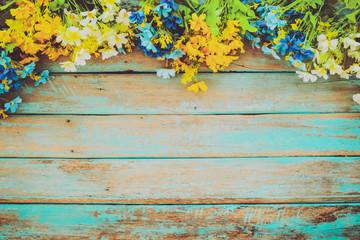Wall Mural - flowers blossom on vintage wooden background, border frame design. vintage color tone - concept flower of spring or summer background
