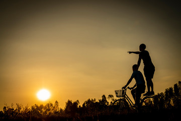 The silhouette of two young men. At Sunset Lifestyle