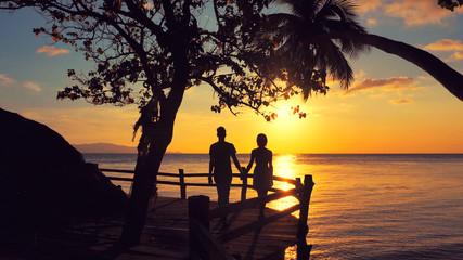 Happy Romantic young Couple enjoying  Beautiful Sea Sunset time