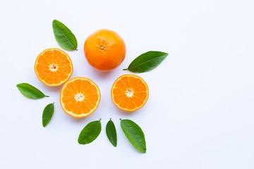 High vitamin C. Fresh orange citrus fruit with leaves isolated on white