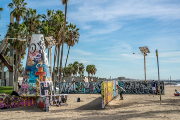 graffiti walls at Venice Beach Los Angeles California Palm Trees in the back