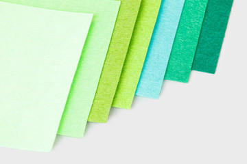 a set of colored sheets of felt, rainbow colors