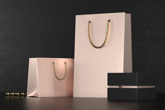 Premium shopping bags mock-up, package for purchases on a black background. Rose gold paper shopping bag with golden handles Mock Up. Luxury bag and black box, 3d rendering.