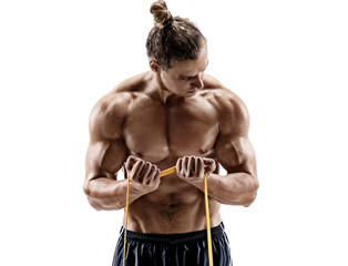Athletic man performing exercises with a resistance band. Photo of strong man shirtless isolated on white background. Strength and motivation.