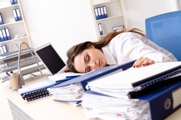 Young female employee unhappy with excessive work
