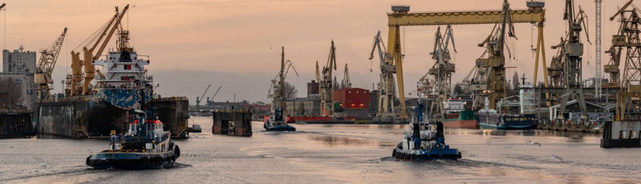 tugs going to work in the port