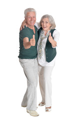 Portrait of senior couple with thumbs up isolated