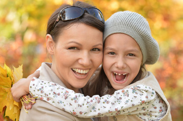 Portrait of happy mother and daughter hugging outdoors