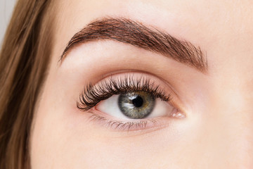 Natural looking eyelash extensions. Good vision and fresh looking eye. Brown eyebrow liner, clear skin