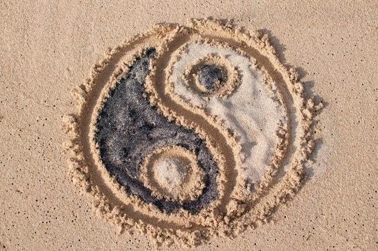 Ying Yang symbol drawn on the beach