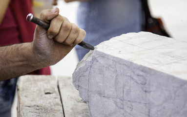 Carving stone, craftsman shaping stone