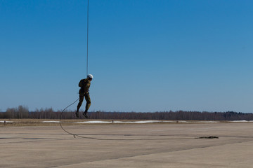 Special Forces descend on a rope