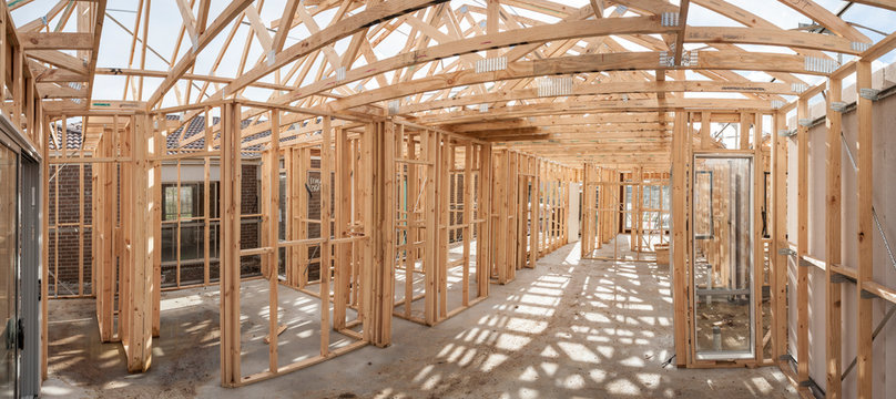 Panoramic interior view of a  wooden timber frame from a new house under construction
