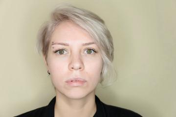 Beauty and fashion concept - Eye lash extension procedure. Young beautiful woman eye with long false eyelashes. Close up macro shot of fashion eyes in beauty salon.