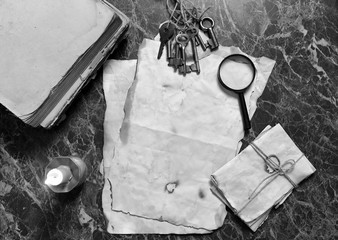 papers and book on detective work table with tools