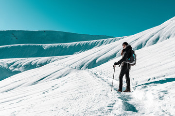 Woman snow hiking in winter
