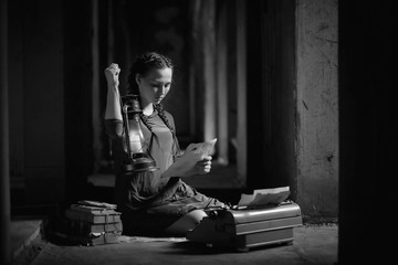Retro girl in the old house reading books