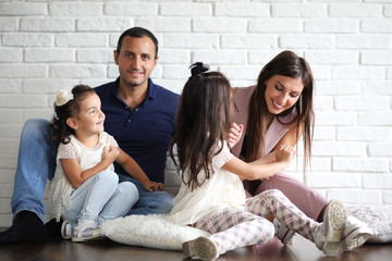 Beautiful young family with daughters