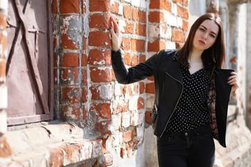 Girl on a walk through the spring city
