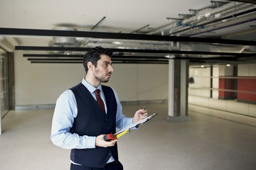 Property surveyor assessing new build commercial office space