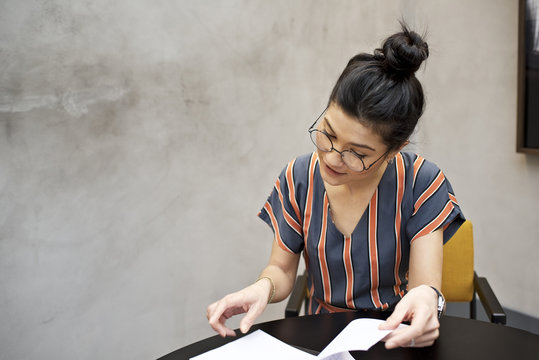 Asian female office worker working at her desk