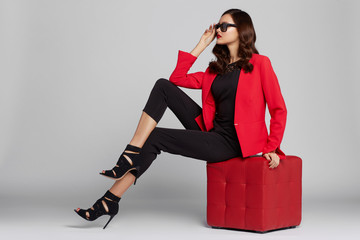 Fashion young woman in red jacket.