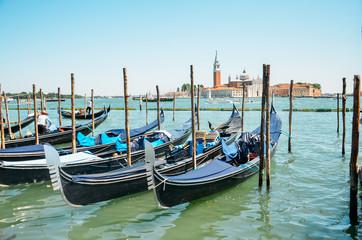 Gondolas in Venice.Beautiful view of traditional Gondola on Canal Grande with San Giorgio Maggiore church in the background, San Marco, Venice, Italy