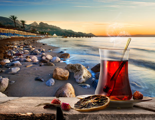 Fototapete - Sea and turkish tea